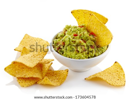 Bowl of guacamole dip and nachos isolated on white background - stock photo