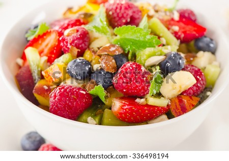 Bowl of healthy fresh fruit salad. Selective focus