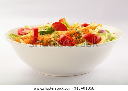 Bowl of Healthy vegetable salad with cabbage,tomato ,carrots,cucumber,lettuce and spices. - stock photo