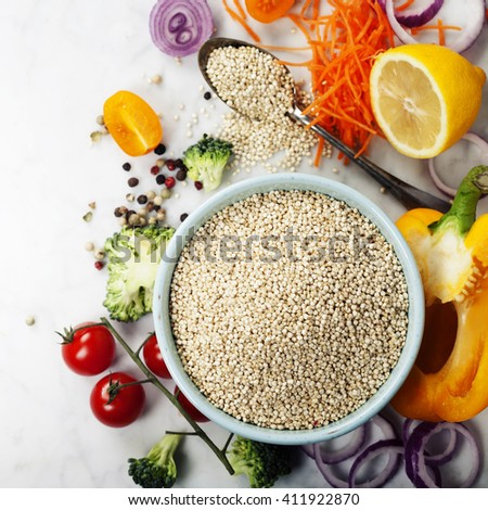 Bowl of healthy white quinoa seeds and fresh organic vegetables - Healthy Eating, Diet, Vegetarian or Cooking concept - stock photo
