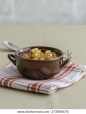 Bowl of hearty homemade minestrone soup with croutons. - stock photo