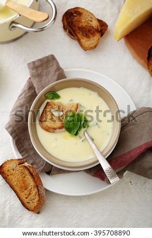 bowl of hot cheese soup, food above - stock photo