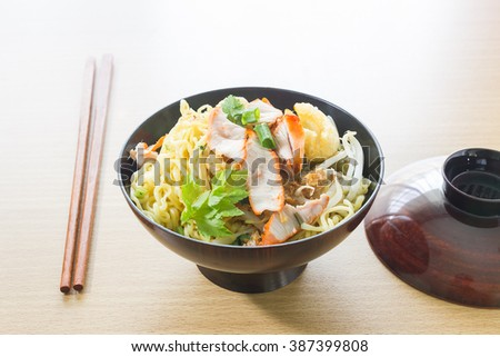 Bowl of Japanese noodle on kitchen table with chopstick - stock photo