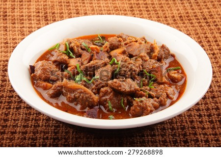 Bowl of lamb curry. - stock photo