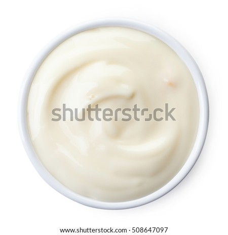 Bowl of mango yogurt isolated on white background from top view