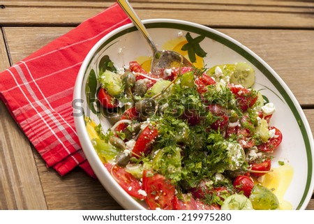 Bowl of Marinated Greek Salad with Red Napkin, Tilted View - stock photo