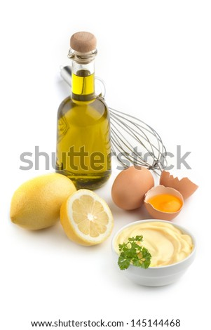 bowl of mayonnaise and ingredients on white background - stock photo