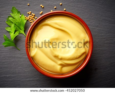 bowl of mayonnaise on black stone background, top view - stock photo