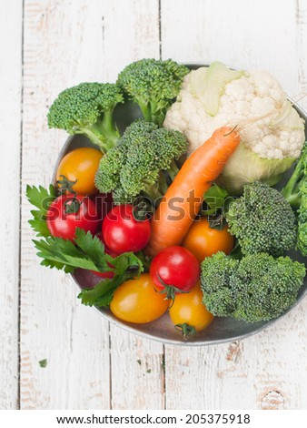 Bowl of mixed fresh vegetables, selective focus