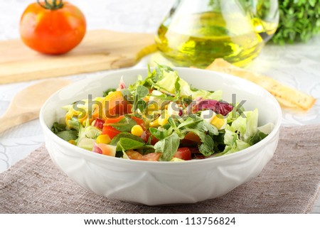 Bowl of mixed salad on complex background - stock photo