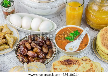 Bowl of Moroccan harira soup,chebakia, dates for iftar - stock photo