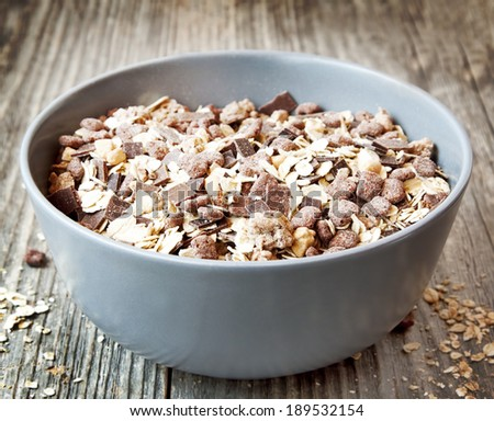 Bowl of Muesli with Chocolate Flakes on Wooden Background - stock photo