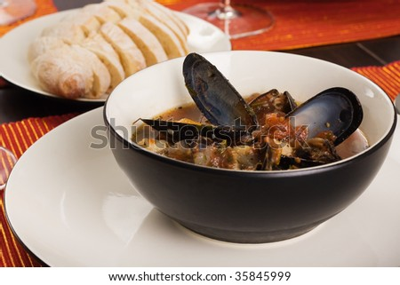 Bowl of Mussel, Shrimp and Scallop Soup - stock photo