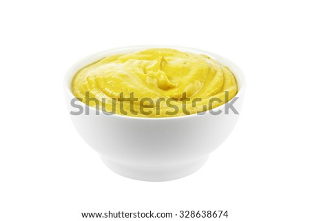 Bowl of mustard isolated on white