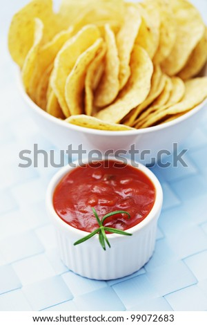 bowl of nachos with salsa with shallow DOF
