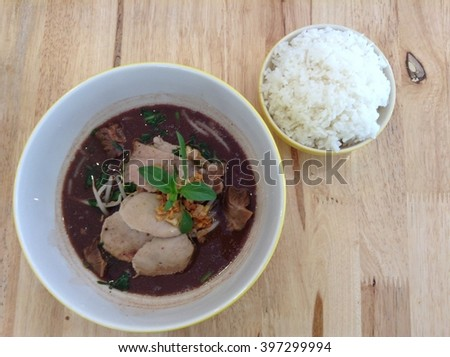 bowl of noodles with beef, vegetables and rice cup on wooden table. delicious noodle. Instant noodle. hot noodle.Homemade Quick Ramen Noodles - stock photo