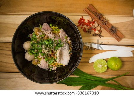 bowl of noodles with vegetables and soft boiled egg on wooden table. delicious noodle. Instant noodle. hot noodle. vegetarian noodle. hot noodle onion soup. Homemade Quick Ramen Noodles  - stock photo