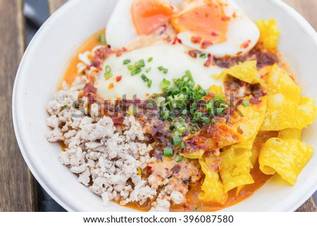 bowl of noodles with vegetables and soft boiled egg on wooden table. delicious noodle. Instant noodle. hot noodle.Homemade Quick Ramen Noodles with egg. - stock photo