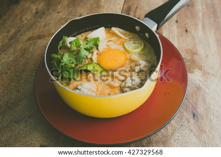 bowl of noodles with vegetables and soft boiled egg on wooden table. delicious noodle. Instant noodle. hot noodle.Homemade Quick Ramen Noodles with egg.vintage color