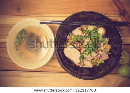 bowl of noodles with vegetables on wooden table. delicious noodle. Instant noodle. hot noodle.Homemade Quick Ramen Noodles vintage color - stock photo