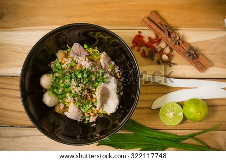 bowl of noodles with vegetables on wooden table. delicious noodle. Instant noodle. hot noodle.Homemade Quick Ramen Noodles - stock photo
