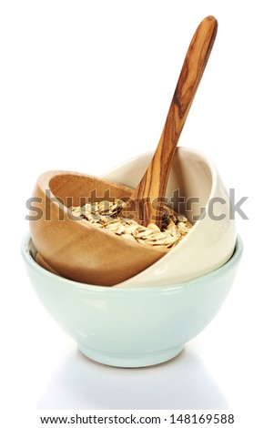 bowl of oat flake on white background - health and diet concept