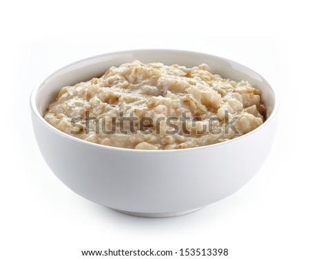 Bowl of oats porridge isolated on a white background. Healthy breakfast - stock photo