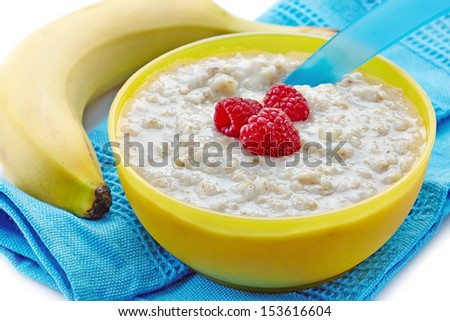 Bowl of oats porridge with fresh berries. Baby food - stock photo