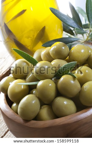 bowl of olives (Manzanilla) with virgin olive oil - stock photo
