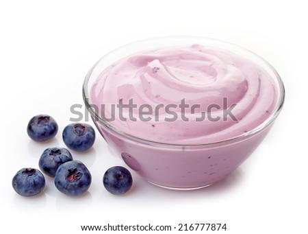 bowl of pink blueberry yogurt isolated on a white background - stock photo