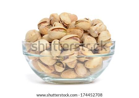 bowl of pistachios isolated on white background - stock photo