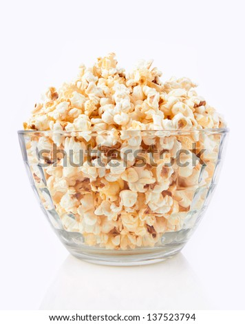 Bowl of popcorn, isolated on a whine background - stock photo