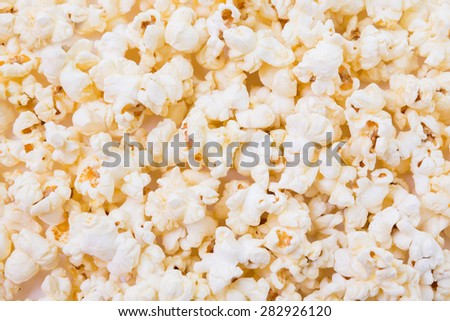 Bowl of popcorn isolated on white background - stock photo