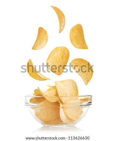 Bowl of potato chips isolayed on white - stock photo