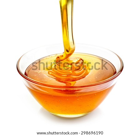 bowl of pouring honey isolated on white background - stock photo