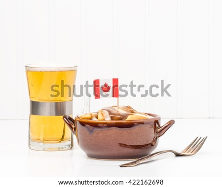 Bowl of poutine, a uniquely Canadian dish originating from the Province of Quebec. - stock photo