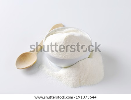 Bowl of powdered milk - stock photo