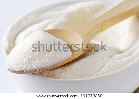 Bowl of powdered milk - stock photo