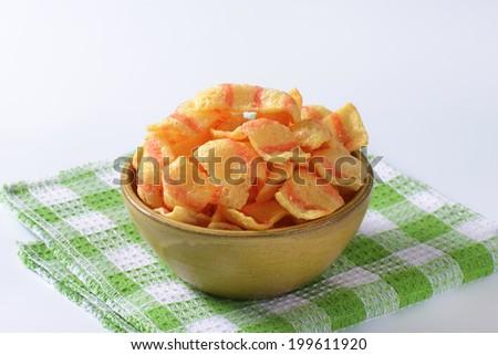 bowl of puffed crisp snacks - stock photo
