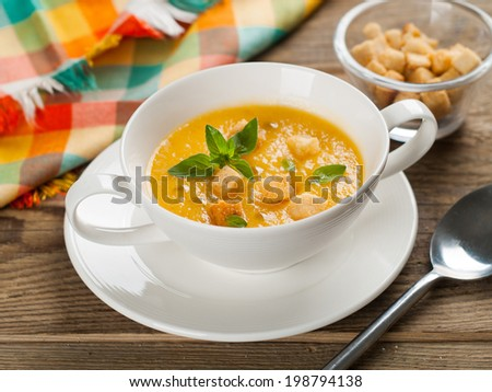 Bowl of pumpkin cream soup,selective focus - stock photo