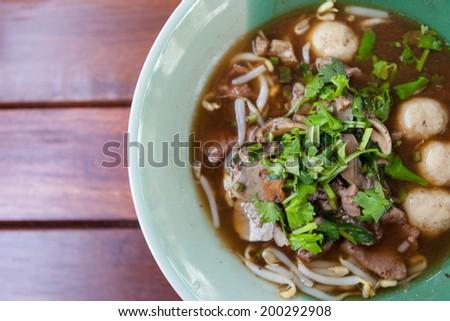 bowl of pungent thai pork noodle soup - stock photo