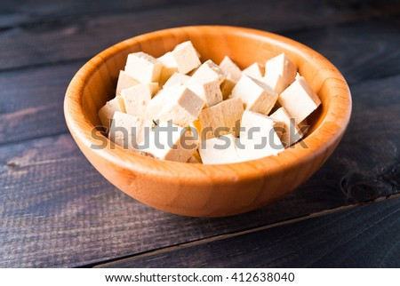 Bowl of raw tofu cubes. Close up - stock photo
