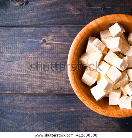 Bowl of raw tofu cubes in bowl. Copy space - stock photo
