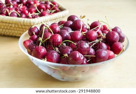 Bowl of red fresh cherries fruit - stock photo