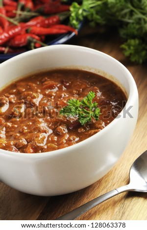 bowl of red hot chili with ground beef, beans and legumes. - stock photo