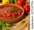 Bowl of red salsa with tortilla chips - stock photo