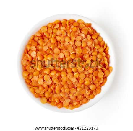 Bowl of red split lentil isolated on white background, top view - stock photo