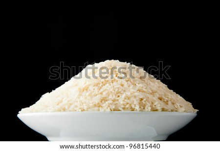 bowl of rice against black background