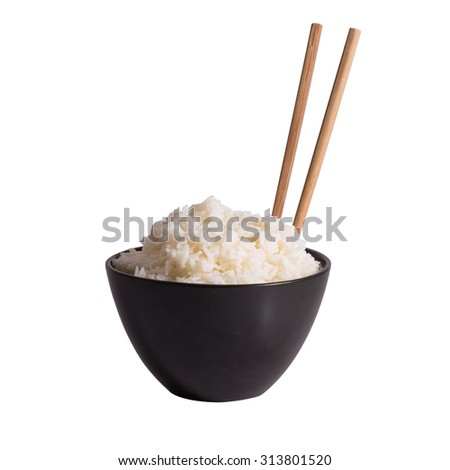 Bowl of rice and chopsticks isolated on white - stock photo