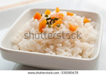 bowl of rice with decorative herbs and carrots